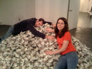 people on pile of money